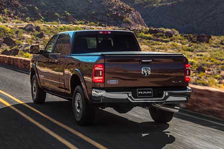 2019-ram-2500-capability-rear-view-driving-mountains